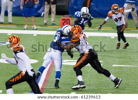 INDIANAPOLIS, IN - SEPT 2: Tackle during football game between Indianapolis Colts and Cincinnati Bengals on September 2, 2010 in Indianapolis, IN - stock photo