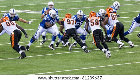 INDIANAPOLIS, IN - SEPT 2: The play begins during football game between Indianapolis Colts and Cincinnati Bengals on September 2, 2010 in Indianapolis, IN - stock photo