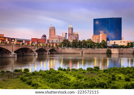 Indianapolis skyline and the White River at sunset - stock photo