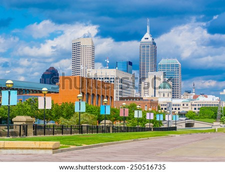 Indianapolis skyline and White River State Park, Indiana. Walkway leads to the downtown area, with capitol building. - stock photo