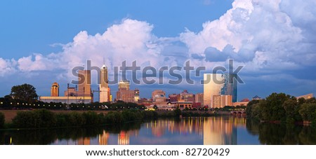 Indianapolis skyline. Panoramic image of Indianapolis skyline at sunset after thunderstorm. - stock photo