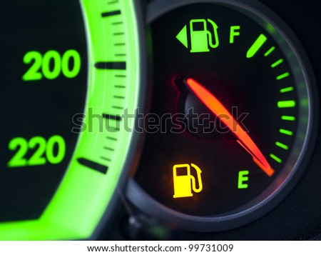 Indicator showing low or nearly empty tank of petrol - stock photo