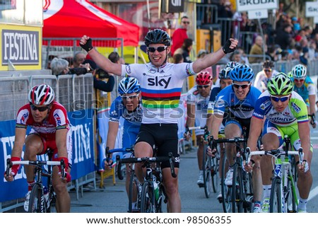 INDICATORE, AREZZO, ITALY - MARCH 08: Mark Cavendish wins the final sprint of the 2nd stage of 2012 Tirreno-Adriatico on March 08, 2012 in Indicatore, Arezzo, Italy - stock photo