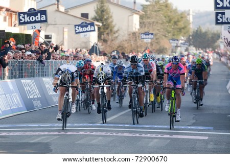 INDICATORE, AREZZO - MARCH 10: Tyler Farrar of Team Garmin Cervelo wins the 2nd stage of 2011 Tirreno-Adriatico, 2nd place for Petacchi, 3rd for Haedo on March 10, 2011 in Indicatore, Arezzo, Italy - stock photo
