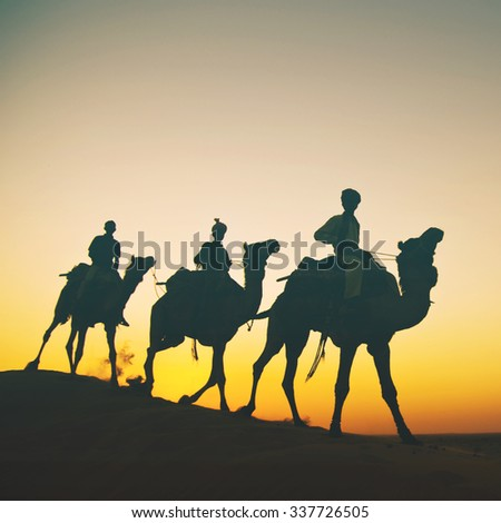 Indigenous Indian Riding Through Desert Camel Concept