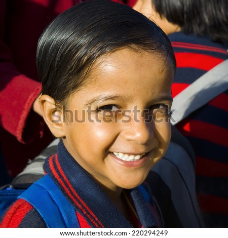 Indigenous Indian school girl smilng at the camera.