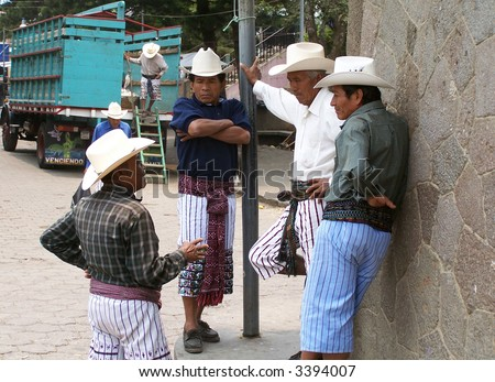 Indigenous men in Chichicastenango (Guatemala) - stock photo