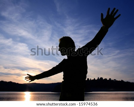 indistinguishable person on background of sunset, freedom and liberty - stock photo