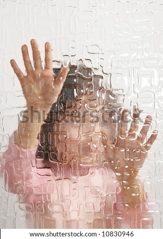 indistinguishable young girl behind pane, depression