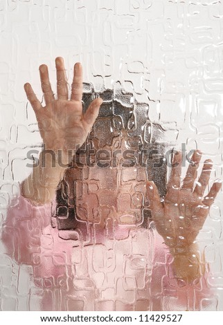 indistinguishable young girl behind pane, depression - stock photo