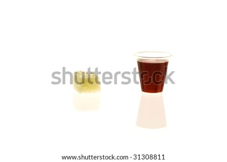 Individual communion cup with bread - stock photo