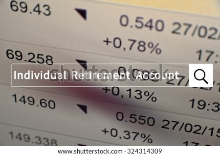 Individual retirement account (IRA) written in search bar with the financial data visible in the background. Multiple exposure photo.