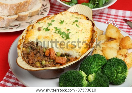 Individual shepherds pie with broccoli and sauteed potatoes. - stock photo