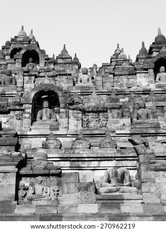 Indonesia, Borobudur, black and white of the Buddha Status of the biggest Buddhism monument in the world. - stock photo