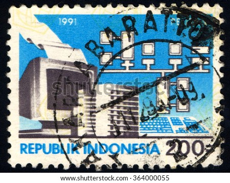 INDONESIA-CIRCA 1991:A stamp printed in Indonesia dedicated to Five Year Development Plan shows Computers, circa 1991 - stock photo