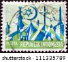 "INDONESIA - CIRCA 1969: A stamp printed in Indonesia from the ""Five-year Development Plan"" issue shows Religious emblems, circa 1969. - stock photo"