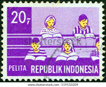 "INDONESIA - CIRCA 1969: A stamp printed in Indonesia from the ""Five-year Development Plan"" issue shows Children in class (Education), circa 1969."