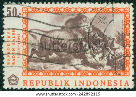 """INDONESIA - CIRCA 1967: A stamp printed in Indonesia from the """"Paintings by Raden Saleh"""" issue shows """"A Fight to the Death"""", circa 1967. - stock photo"""
