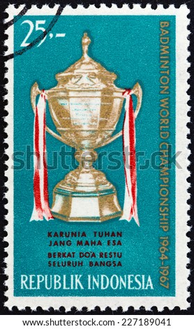 """INDONESIA - CIRCA 1964: A stamp printed in Indonesia from the """"Thomas Cup World Badminton Championships """" issue shows Thomas Cup, circa 1964.  - stock photo"""