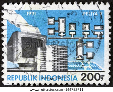 INDONESIA - CIRCA 1991 A stamp printed in Indonesia shows computer, circa 1991  - stock photo