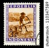 """INDONESIA-CIRCA 1947: A stamp printed in Indonesia shows Peasant with spelling """"Repoeblik"""", without inscription, from series """"Indonesian Vienna Issues"""", circa 194 - stock photo"""