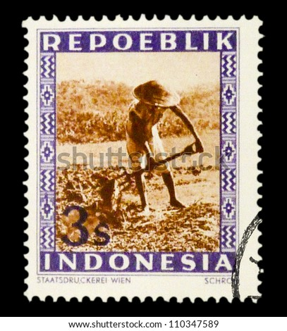 "INDONESIA-CIRCA 1947: A stamp printed in Indonesia shows Peasant with spelling ""Repoeblik"", without inscription, from series ""Indonesian Vienna Issues"", circa 194 - stock photo"