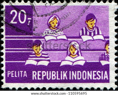 INDONESIA-CIRCA 1960: A stamp printed in Indonesia shows students in the classroom, circa 1960