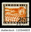 """INDONESIA-CIRCA 1947: A stamp printed in Indonesia shows Sukarno and soldiers with spelling """"Repoeblik"""", without inscription, from series """"Indonesian Vienna Issues"""", circa 1947 - stock photo"""