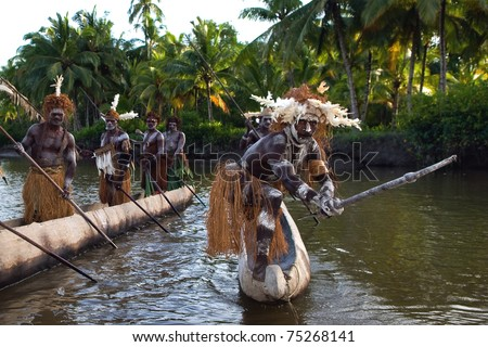 INDONESIA, IRIAN JAYA, ASMAT PROVINCE -  JANUARY 18: Headhunters of a tribe of Asmat show traditional and national customs, dresses, the weapon and boats.New Guinea Island, Indonesia. January 18 2009 - stock photo