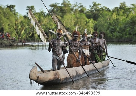 INDONESIA, IRIAN JAYA, ASMAT PROVINCE, JOW VILLAGE - JUNE 28: Canoe war ceremony of Asmat people. Headhunters of a tribe of Asmat . New Guinea Island, Indonesia. June 28 2012 - stock photo