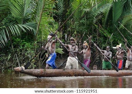 INDONESIA, IRIAN JAYA, ASMAT PROVINCE, JOW VILLAGE - JUNY 28: Canoe war ceremony of Asmat people. Headhunters of a tribe of Asmat . New Guinea Island, Indonesia. June 28 2012 - stock photo