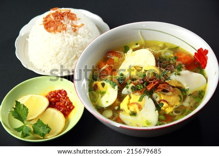 Indonesian chicken soto or soto ayam, served with white rice, and chili sauce - stock photo