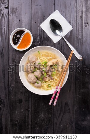 Indonesian Meatball Bakso Noodle with sweet soy sauce and chilli sauce sprinkle with green onion - stock photo