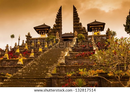 indonesian old temple pura Besakih on a cloudy sunset background. Bali.