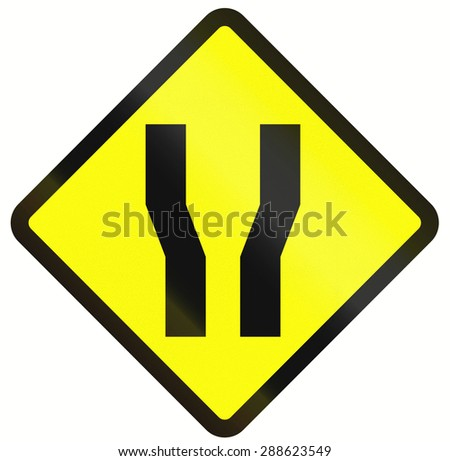 Indonesian road warning sign: Road widens on both sides. - stock photo