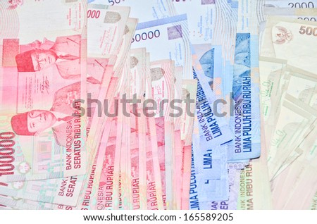 Indonesian Rupiah on a white background. - stock photo