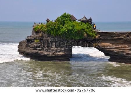 Indonesian temple on sea coast. Tanah lot complex. Bali. Indonesia - stock photo