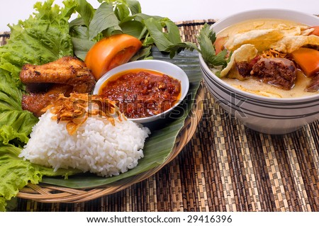 Indonesian traditional food, fried chicken and oxtail soup - stock photo