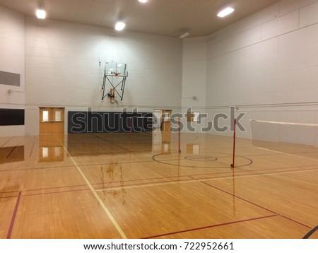 indoor basketball court with badminton net