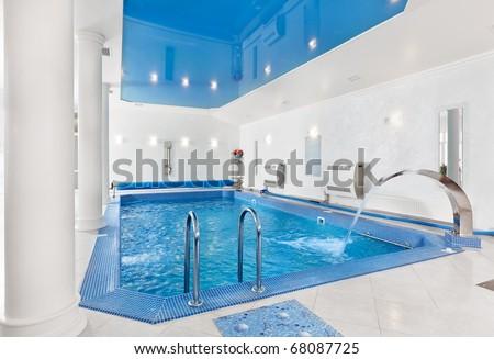 Indoor big blue swimming pool interior in modern minimalism style - stock photo