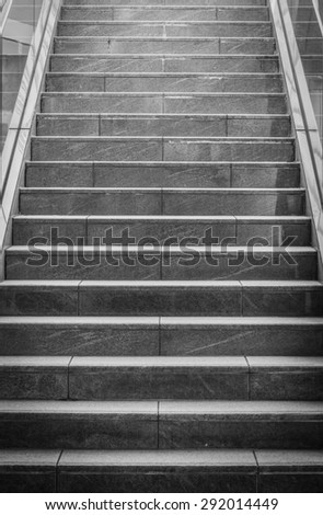 Indoor black concrete stairs in modern building - stock photo