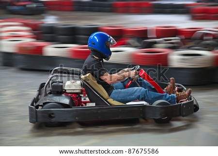 Indoor carting race (cart and safety barriers) - stock photo