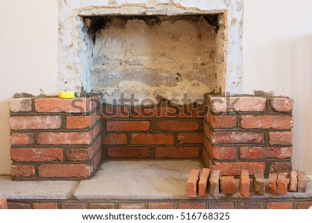Brick wall rusty pipe stock photo 524151064 shutterstock for Building an indoor fireplace