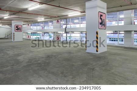 Indoor empty parking lot - stock photo