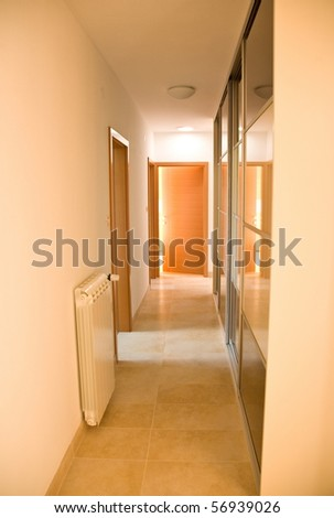 indoor house corridor with closet and radiator and doors - stock photo
