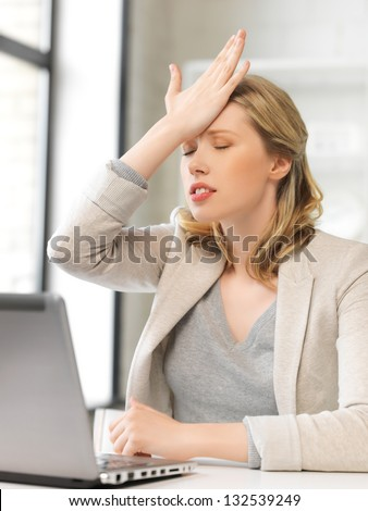 indoor picture of businesswoman holding her head with hand - stock photo