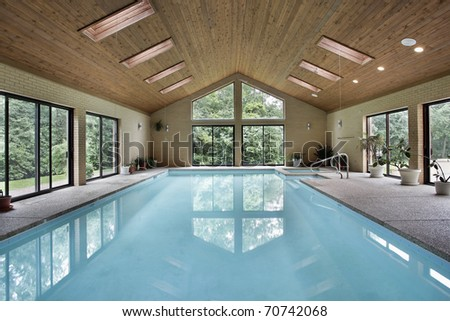 Indoor pool in luxury home with skylights - stock photo