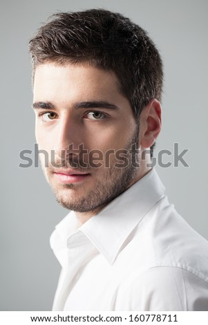 Indoor portrait of a handsome young Caucasian man. - stock photo