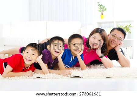 Indoor portrait of asian family