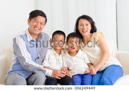 Indoor portrait of asian family - stock photo